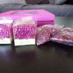 perles de pluie fushia. j en ai aussi des transparentes. CH 3 par boite.